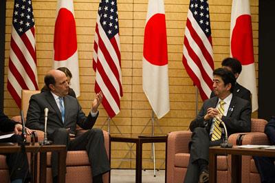 Japanese Prime Minister Shinzo Abe speaks with U.S. Ambassador to Japan John V. Roos. U.S. Department of State