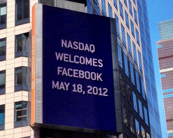 An electronic billboard on the Thomson Reuters building welcomes Facebook, Inc. to the Nasdaq. Author: ProducerMatthew