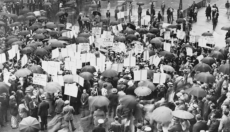 Crowd of depositors gather in the rain outside Bank of United States after its failure.
