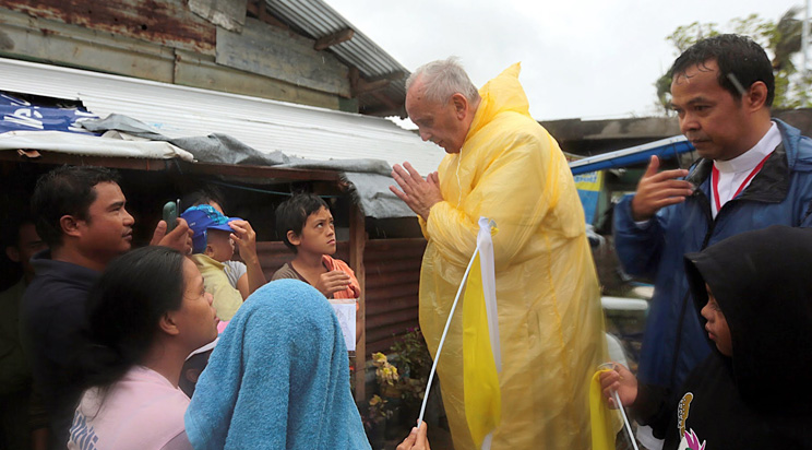 Pope Francis Environment Laudato Si. Pope Francis visits the Typhoon Yolanda victims in one of the areas in Palo, Leyte earlier today, January 17, 2015. Source: Malacanang Photo Bureau. Author: Benhur Arcayan