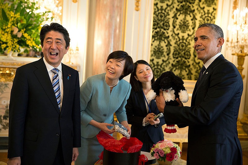 President Barack Obama holds up a Bo golf club cover, a gift given to him by Prime Minister Shinzo Abe and Mrs. Akie Abe at Akasaka Palace in Tokyo, Japan, April 24, 2104. (Official White House Photo by Pete Souza)
