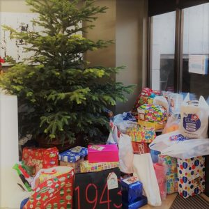 Christmas presents collected by Social Action Club for 101 children in-need