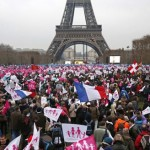 Thousands of demonstrators gather on the Champ de Mars near the Eiffel Tower in Paris