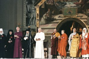 Pope John Paul II attends an interreligious peace meeting in Assisi, Italy, in this Oct. 27, 1986, file photo. Pope Francis will join dozens of religious leaders in Assisi Sept. 20 for an interfaith peace meeting marking the 30th anniversary of the 1986 encounter. Pictured from left are: Metropolitan Filaret of the Russian Orthodox Church; Bishop Gabriel of Palmyra, representing the Greek Orthodox Church of Antioch; Orthodox Archbishop Methodios; Archbishop of Canterbury Robert Runcie, spiritual head of the worldwide Anglican Communion; Pope John Paul II; the Dalai Lama; Venerable Maha Ghosananda of Cambodia; Venerable Eui-Hyun Seo of Korea; and Venerable Etai Yamada of Japan. (CNS photo/L'Osservatore Romano) See POPE-ASSISI-PEACE Sept. 1, 2016.